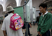 EXCLUSIVE<br /> The Pyongyang subway<br /> The best place to escape american fire and fury<br /> <br />  Built in 1970s, Pyongyang Metro may soon become the best place for north koreans to escape « fire and the fury like the world has never seen » that promises Donal Trump. It includes only 17 stations on two lines, with a total length of 30 km. In Seoul it is about 300 km. Construction of the metro service began in 1968 and was inaugurated in 1973 by Kim Il Sung, the grandfather of Kim Jong Un.  Before entering the platform, one must purchase a ticket and go through the checkpoint. The fare is cheap, only 5 wons, half of a US cent.<br /> You have to validate your ticket at one of these automatic machines. But they did not work the day I visited. Instead, a train attendant checked was checking the tickets by hand.  Like in so many others places, the visits of the Dear Leaders are immortalized by a red billboard telling the date they visited the place.<br /> So you will learn Kim Il Sung used this escalator. You can also find out what he has done in his life, as the North korean propaganda set up a billboard every time<br /> they visited a place.  There are only 2 metro lines, so getting lost is not easy.<br /> Each station is named after the revolution: Comrade, Red Star, Glory, Liberation, Signal Fire, Rehabilitation, Victory, Paradise, Restoration... not named after places though.  Going down the 120 meters takes just few seconds but you feel like being in a movie as the revolutionary music and patriotic songs are played all around from the loudspeakers.<br /> Everybody stays at his/her place, no one tries to jump the queue.<br /> ©Eric lafforgue/Exclusivepix media
