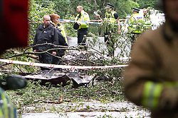 © Licensed to London News Pictures . 01/08/2015 . Cheshire , UK . Scene across Coach Road in Oulton Park , Cheshire , where a plane has crashed and one person has died this afternoon (1st August 2015) during the Carfest2015 event . Photo credit : Joel Goodman/LNP