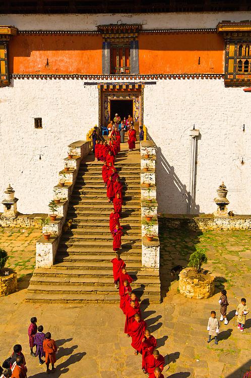 Procession of monks leaving the Paro Dzong going to the Paro Tsechu (Festival), Paro, Bhutan