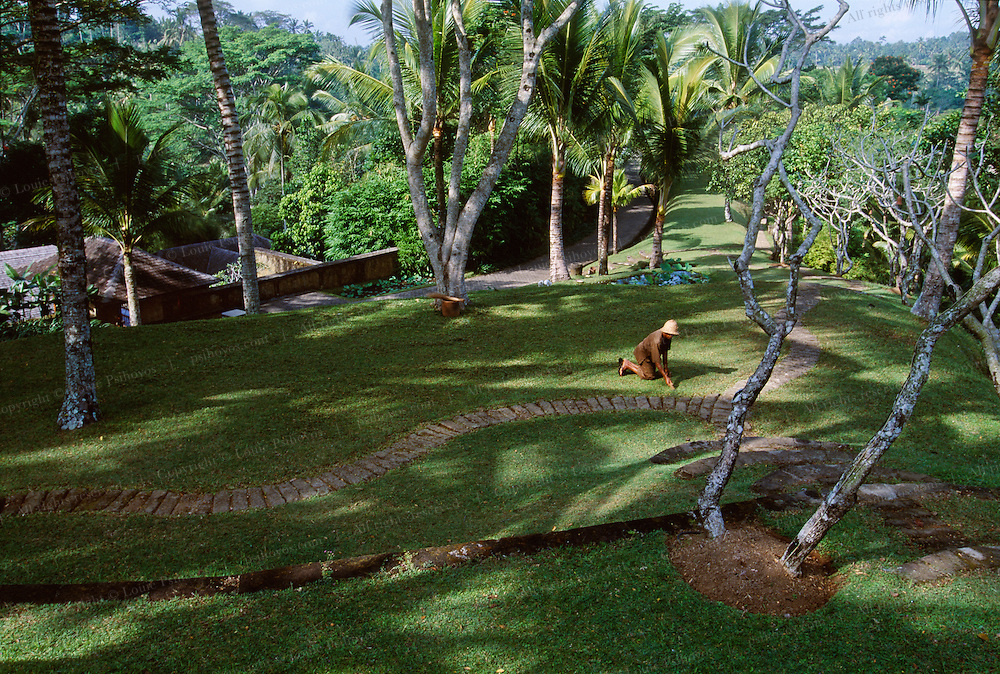 The Begawan Giri Resort in Bali, Indonesia was rated the top small hotel in the world in 2002 by Conde Nast Traveler Magazine. Groundskeepers cut the grass by hand at this exclusiove resort.