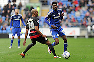 Cardiff City's Sammy Ameobi (r) passes past QPR's Karl Henry. Skybet football league championship match, Cardiff city v Queens Park Rangers at the Cardiff city stadium in Cardiff, South Wales on Saturday 16th April 2016.<br /> pic by Carl Robertson, Andrew Orchard sports photography.