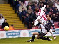 Photo Pete Downing<br />Sheffield Utd V Burnley.<br />Nationwide division one.<br /> 8/11/ 2003.<br /> Peter Ndlovu on the attack for sheffield.<br /><br />Photo:Peter Downing