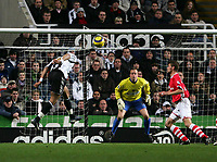 Photo: Andrew Unwin.<br /> Newcastle United v Charlton Athletic. The Barclays Premiership. 22/02/2006.<br /> Newcastle's Jean Alain Boumsong (L) directs his header straight at Charlton's goalkeeper, Thomas Myhre (C).