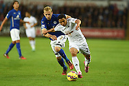Jefferson Montero of Swansea city holds off Leicester city's Ritchie De Laet. Barclays Premier league match, Swansea city v Leicester city at the Liberty stadium in Swansea, South Wales on Saturday 25th October 2014<br /> pic by Andrew Orchard, Andrew Orchard sports photography.
