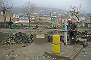 A man fetches water in Kabul, Afghanistan.
