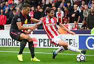 Joe Allen of Stoke city (r)  in action. Premier league match, Stoke City v Arsenal at the Bet365 Stadium in Stoke on Trent, Staffs on Saturday 19th August 2017.<br /> pic by Bradley Collyer, Andrew Orchard sports photography.