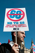 March 28th 2012. Demonstration organised by NUT (National Union of Teachers) to protest against changes to pensions and retirement age. Man holding placard saying 'No to 68' , the proposed retirement age.
