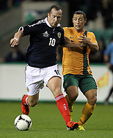 Football - Challenge Match -  Scotland vs. Australia<br /> <br /> Charlie Adam of Scotland competes with Scott McDonald of Australia during the Vauxhall International Challenge match at Easter Road, Edinburgh on August 15th 2012<br /> <br /> Ian MacNicol/Colorsport
