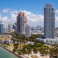 Aerial South Pointe Park, Miami Beach and condominiums right to left, Continuum South, South Pointe Tower, Portofino Tower, Yacht Club at Portofino (yellow building) and  Murano at Portofino