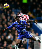 Photo: Tom Dulat/Sportsbeat Images.<br /> <br /> Chelsea v Sunderland. The FA Barclays Premiership. 08/12/2007.<br /> <br /> Kenwyne Jones of Sunderland and Mikel of Chelsea head for the ball.