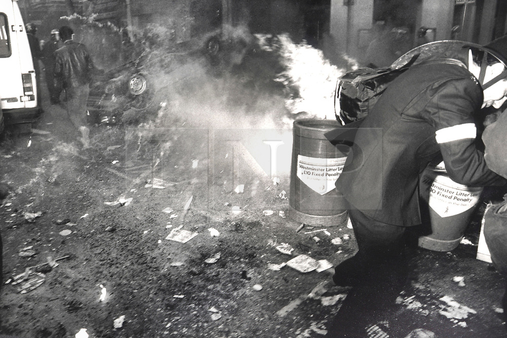 © Licensed to London News Pictures. 25/03/2020. London, UK. In this image from March 31st 1990 a police officer reacts as a burning car's fuel tank explodes on Charing Cross Road during the London poll tax riots. The protest on the last day of March in 1990 started peacefully when thousands gathered in a south London park to demonstrate against Margaret Thatcher's Government's introduction of the Community Charge - commonly known as the poll tax. Marchers walked to Whitehall and Trafalgar Square where violence broke out with the trouble spreading up through Charring Cross Road and on to the West End. Police estimated that 200,000 people had joined the protest and 339 were arrested. The hated tax was eventually replaced by the Council Tax under John Major's government in 1992.  Photo credit: Peter Macdiarmid/LNP
