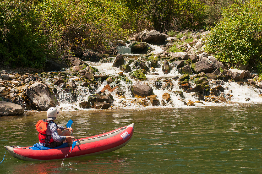 Kayaker enjoying Papoose Creek in The Impassible Canyon on the Middle Fork of the Salmon River during six day rafting vacation, Idaho.