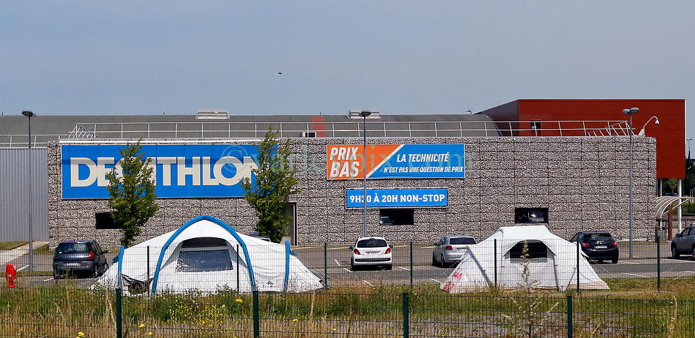 26 June 2020. Calais, France.<br /> Decathlon sports supply store in Calais. It is alleged migrants are supplied with tents and other essential survival equipment from Decathlon and other sporting equipment stores in the region. Ruthless Albanian gangs running migrant camps allegedly provide kayaks, surf boards and even paddling pools which desperate migrants pay way over the top prices to the smugglers for in their often desperate and dangerous attempts to cross the English Channel (La Manche) as they   seek to make better lives for themselves in Britain.<br /> Photo©; Charlie Varley/varleypix.com