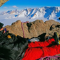 A mountaineer bivouacs near summit of Troll's Castle, Filchner Mountains.
