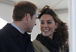 Prince William and his fiancee Kate Middleton smile during a Naming Ceremony and Service of Dedication for the Royal National Lifeboat Instution's (RNLI) new Atlantic 85 Lifeboat 'Hereford Endeavour', at Trearddur Bay Lifeboat Station, in Trearddur Bay, Anglesey in north Wales.