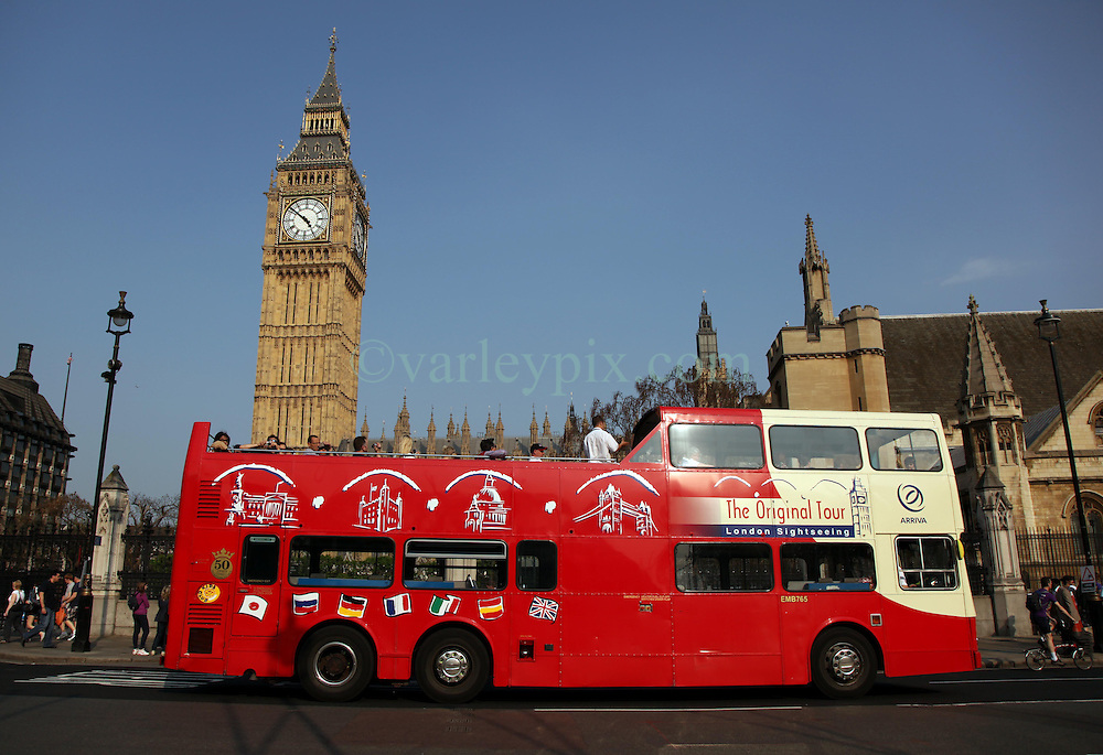 21 April 2011. London, England..A double decker tourist bus passes Big Ben and the Houses of Parliament, part of the Royal wedding route the procession will pass en route to Buckingham Palace in the run up to Catherine Middleton's marriage to Prince William..Photo; Charlie Varley.
