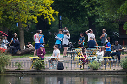 © Licensed to London News Pictures. 29/05/2021. London, UK. Members of the public enjoy the sunny weather in Victoria Park, east London.  Photo credit: Marcin Nowak/LNP