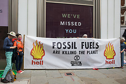 Environmental activists from Extinction Rebellion hold a banner referring to fossil fuels during the first day of Impossible Rebellion protests on 23rd August 2021 in London, United Kingdom. Extinction Rebellion are calling on the UK government to cease all new fossil fuel investment with immediate effect. (photo by Mark Kerrison/In Pictures via Getty Images)