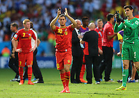 Eden Hazard of Belgium and Goalkeeper Thibaut Courtois of Belgium applaud at the end of the match in which Belgium got knocked out of the FIFA World Cup