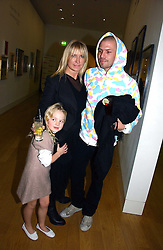 MEG MATHEWS and DUSTIN BURGESS with her daughter ANAIS GALLAGHER at the opening of an exhibition entitled Exceptional Youth supported by Teen Vogue at the National Portrait Gallery, London on 3rd November 2006.<br />
