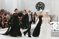 German designer Karl Lagerfeld flanked by models (Luca Gadjus - right) walks on the runway for Chanel Haute-Couture Spring-Summer 2005 collection presentation in Paris, France, January 25, 2005. Photo by Java/ABACA