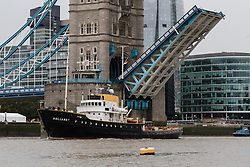 © Licensed to London News Pictures. 29/09/2016. LONDON, UK. Tower Bridge bascules are seen raised this morning as they lift to allow the Dutch heritage tug, MV Holland to pass underneath. 122 year old Tower Bridge will close entirely to traffic for three months from 1 October and will include major maintenance to the bridge lifting mechanisms. During this time, the bascules, which are raised 800-900 times per year will be maintained as operable to river traffic. As well as large ships, Tower Bridge regularly opens to allow vessels with tall masts to pass under, such heritage tug, MV Holland who passed underneath this morning.  Photo credit: Vickie Flores/LNP