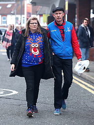Fans make their way to the stadium prior to the Premier League match at Selhurst Park, London.