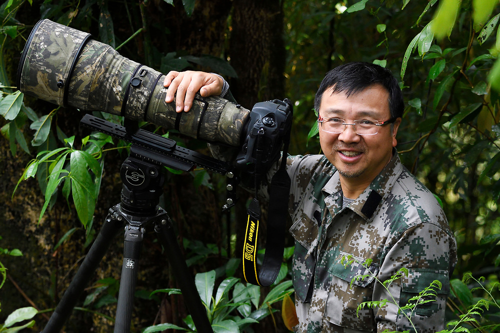 Portrait of chinese Photographer Wei Jun, Tongbiguan nature reserve, Dehong prefecture, Yunnan province, China