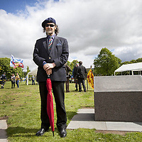 """Poet and Guardians trustee, Paraig MacNeil, standing beside the lectern containing an excerpt from his De Moray Epic Poem.<br /> <br /> BRAVEHEART HEROES, WILLIAM WALLACE AND ANDREW DE MORAY, FINALLY HONOURED AT STIRLING BRIDGE BATTLE SITE AS SALTIRE RAISED FOR FIRST TIME IN OVER 700 YEARS<br /> <br /> Friday 29th May, 2015<br /> <br /> IT'S TAKEN more than 700 years but today, the two heroes at the centre of one of the most important battles in Scottish history have been jointly honoured at the spot where they both led an outnumbered Scottish army to victory against the English.<br /> The formal unveiling ceremony at Stirling Bridge today (Friday 29th May), of three lecterns made of traditional Scottish whinstone dedicated to the memory of William Wallace and Andrew de Moray,at site of the historic victory at Battle of Stirling Bridge.<br /> At a special ceremony attended by Andrew de Moray's direct descendant, the Earl of Moray, and Stewart Maxwell, MSP, convener of the Scottish Parliament's Education and Culture Committee, the memorials were formally unveiled.Mr Maxwell opened the event and after the dedication, together with the Earl of Moray, they raised the Saltire together at the site of the Battle of Stirling Bridge. This is the first time in over 700 years that the Saltire has flown at Stirling Bridge. The flag will now become a permanent fixture at the site of the Battle.<br /> John Stuart, the current Earl of Moray, said of his illustrious kinsman: """"I am delighted that Andrew de Moray is finally, after 700 years, to have the recognition he deserves. The Guardians of Scotland have put a huge amount of time and effort into the lecterns, which are a very fitting tribute to one of Scotland's greatest patriots.""""<br /> The victory represented a key moment in the Scottish Wars of Independence. Eminent Scots historian, Sir Tom Devine, recently described the battle as being 'second in importance only to Bannockburn in the Wars of Independence'.<br /> It is the fir"""