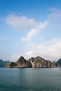 Limestone karsts and islands in Ha Long Bay on a sunny day with blue sky, near Cat Ba Island, Vietnam