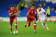 Craig Bellamy (l) and Neil Taylor of Wales make a break.  Euro 2012 Qualifying match, Wales v Montenegro at the Cardiff City Stadium in Cardiff  on Friday 2nd Sept 2011. Pic By  Andrew Orchard, Andrew Orchard sports photography,
