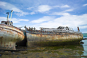 Disused derelict fishing boats at Salen Bay in the Sound of Mull on Isle of Mull, West Coast of Scotland