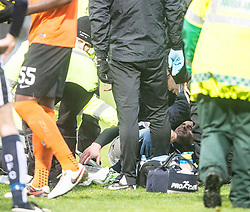 Dundee's James McPake injured after he had tackled  Dundee United's John Rankin, and he gets stretchered off. <br /> Half time : Dundee 1 v 1  Dundee United, SPFL Ladbrokes Premiership game played 2/1/2016 at Dens Park.