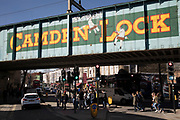 Famous sign for Camden Lock at this busy hang out for young Londoners and tourists in Camden Town, London, England, United Kingdom. Camden Town is famed for its market, warren of fashion and shops near Regent's Canal, and is a haven of alternative counter culture.