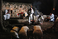 """Mexico, Yucatan, Mayapan, October 17, 2010. Mayan high priest Ildelfonso Ake Cocom conducts a """"saka"""" purification ceremony on the grounds of Mayapan, a ruined Yucatecan capital city dating from the period between 1220 and 1240 AD. Photographs commissioned by SECTUR."""