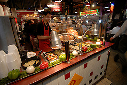 Reading Terminal Market, preparing food..Philadelphia, Pennsylvania, PA USA.  Photo copyright Lee Foster, 510-549-2202, lee@fostertravel.com, www.fostertravel.com.  Photo 235-30529