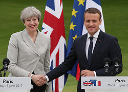 French President Emmanuel Macron and Prime Minister Theresa May shake hands after holding a joint press conference at the Elysee Palace during her visit to Paris, France.