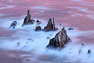 The dawn is reflected in the sea around rocky peaks, Asturias, Spain<br /> <br /> Das Morgenrot spiegelt sich im Meer rund um Felszacken, Asturien, Spanien