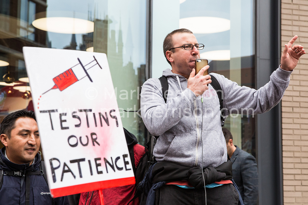 London, UK. 30th October, 2018. Jason Moyer-Lee, General Secretary of the Independent Workers of Great Britain (IWGB) trade union, addresses members and supporters marching together with other precarious workers from the offices of Transport for London to the University of London via the Court of Appeal in support of Uber drivers who are seeking employment rights. The Court of Appeal will today hear an appeal by Uber against a ruling that its drivers are employees rather than self-employed workers.