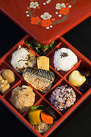 """The origin of bento can be traced back to the Kamakura Period when cooked and dried rice called hoshi-ii literally """"dried meal"""" was developed. In the Edo Period bento culture spread and became more refined. Bento became even more popular in the 80s with the help of the microwave and the proliferation of convenience stores. The expensive wood and metal boxes have been replaced at most bento shops with inexpensive, disposable plastic ones Even handmade bento have made a comeback, and they are once again a common sight at picnics."""