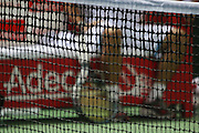 Tennis concept out of focus tennis players resting