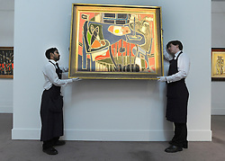 © licensed to London News Pictures. LONDON, UK.  10/06/11. Patrick Heron's 'Table with Fishes' has not been seen since 1965 and is estimated to fetch £250,000 350,000. Preview of Sotheby's upcoming Evill/Frost Collection Sale. Highlights from the collection of 20th century British art include an early work by Lucian Freud, bought for £18 in 1944, and now estimated at £400,000 to £600,000, a Henry Moore sculpture of a mother and child in a rocking chair that was designed as a moving toy for his daughter, estimated at £800,000 to £1.2 million and Stanley Spencer's Workmen in the House, estimated at £1.5 £2.5 million. The auctions take place on June 15 and 16.. Photo credit should read Stephen Simpson/LNP