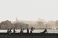 Cuban men fish on the Malecon in Havana, Cuba. (December 3, 2014)