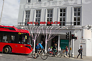 The UK government has announced a Coronavirus pandemic financial rescue package for the Arts industry, a £1.15bn support for cultural organisations in England which is made up of £880m in grants and £270m of repayable loans. But venues such as The Old Vic theatre in Waterloo will remain for the foreseeable future, on 6th July 2020, in London, England. Some theatres in London and others around the country have been wrapped in bright pink barrier tape, which reads Missing Live Theatre -  a protest project led by stage designers group Scene Change. The arts and culture arts industry supports 137,250 jobs and is worth £21.2bn in direct turnover.