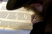 A new Sefer Torah (five books of Moses) being handwritten with a quill and ink on gevil parchment by a scribe for an Ashkenazi synagogue in Stamford Hill. A Sefer Torah contains 304,805 letters and can take over a year to produce.