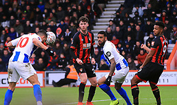 Brighton & Hove Albion's Florin Andone (left) scores his side's third goal of the game during the Emirates FA Cup, third round match at the Vitality Stadium, Bournemouth.