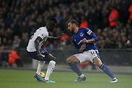 Cenk Tosun of Everton attempts to get past Davinson Sanchez of Tottenham Hotspur.<br /> Premier league match, Tottenham Hotspur v Everton at Wembley Stadium in London on Saturday 13th January 2018.<br /> pic by Kieran Clarke, Andrew Orchard sports photography.