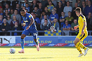 AFC Wimbledon midfielder Liam Trotter (14) dribbling during the EFL Sky Bet League 1 match between AFC Wimbledon and Oxford United at the Cherry Red Records Stadium, Kingston, England on 29 September 2018.