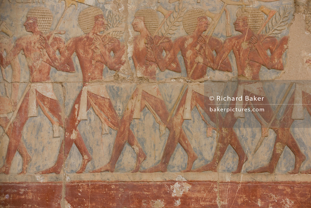 """A detail of ancient Egyptian hieroglyphs showing Somalian slaves at the ancient Egyptian Temple of Hatshepsut near the Valley of the Kings, Luxor, Nile Valley, Egypt. The Mortuary Temple of Queen Hatshepsut, the Djeser-Djeseru, is located beneath cliffs at Deir el Bahari (""""the Northern Monastery""""). The mortuary temple is dedicated to the sun god Amon-Ra and is considered one of the """"incomparable monuments of ancient Egypt."""" The temple was the site of the massacre of 62 people, mostly tourists, by Islamists on 17 November 1997."""