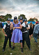 Glastonbury Festival, 2015.<br /> A fun intereaction between the police and a young festival goer in face paint and a dress.